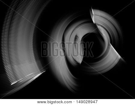 Abstract grey swirling fractal on black background