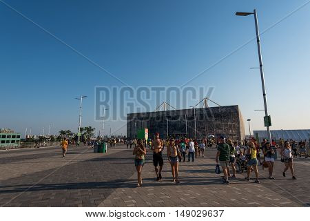Rio de Janeiro, Brazil - September 12, 2016: Visitors walk in the Paralympic Park during the games.