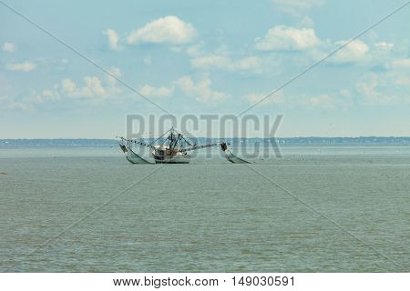 Shrimp boat dragging cast nets near Beaufort, South Carolina. Can be paired with video by same artist