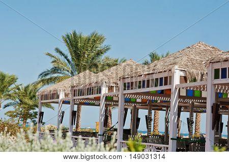 Tropical Pavillion On The Beach Background Palms