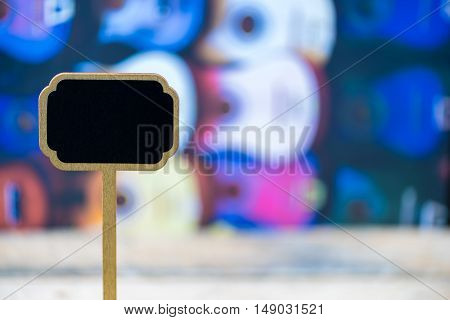 Wooden Mini Blackboard Label Over Colorful Traditional Mexican Guitars Background