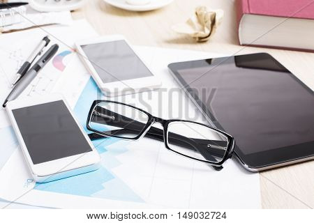 Closeup Of Blank Smartphones And Tablet