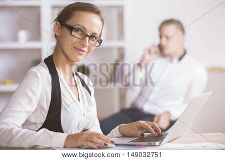 Businesswoman Using Laptop Side