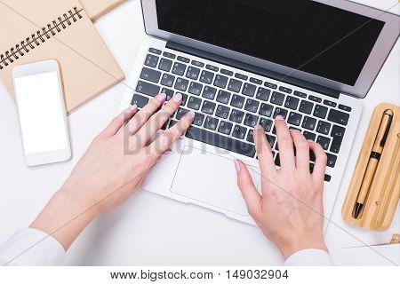 Woman Typing On Keypad Closeup