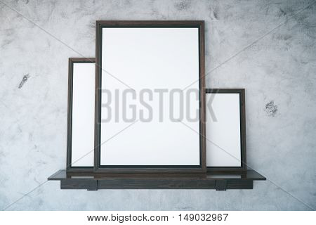 Wooden shelf with empty picture frames on textured concrete wall background. Mock up 3D Rendering