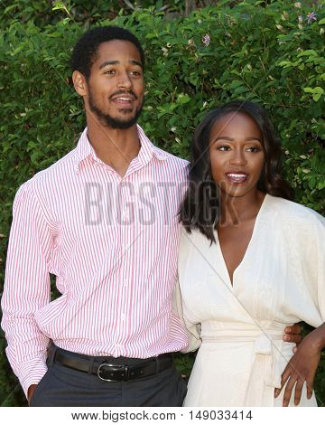 LOS ANGELES - SEP 25:  Alfred Enoch, Aja Naomi King at the The Rape Foundation's Annual Brunch at the Private Residence on September 25, 2016 in Beverly Hills, CA