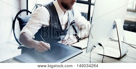 Closeup Bearded Creative Director Working Drawing Digital Tablet Desktop Computer Wood Table.Stylish Young Man Wearing Glasses White Shirt Waistcoat Work Modern Loft Online Startup Project.Blurred