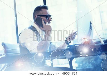 Bearded Businessman Planning Global Strategy Virtual Screen.Startup Concept Innovation Graphs Interfaces Icon.Man Analyzes Business Modern Workplace.Young Guy Working Online Project Desktop.Blurred