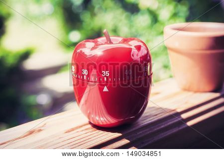 35 Minute Kitchen Egg Timer In Apple Shape Standing On A Handrail