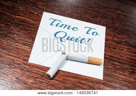 Time To Quit Smoking Reminder With Broken Cigarette On Wooden Shelf