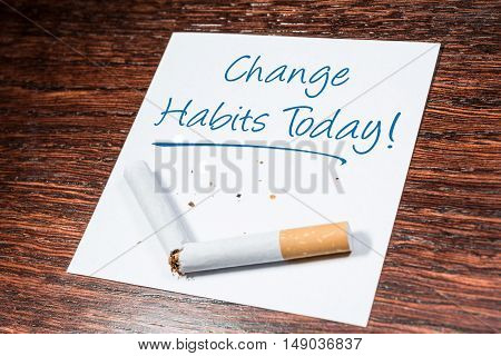 Change Smoking Habit Reminder With Broken Cigarette On Wooden Shelf