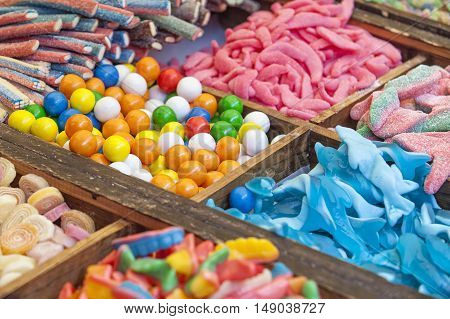 Colorful sweets candied and jellies at street market stall