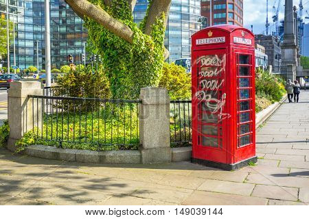 LONDON, ENGLAND - May 14, 2016 : Traditional red phone boths on the street of London, England. London is the capital and most populous city of England, Britain, and the United Kingdom.