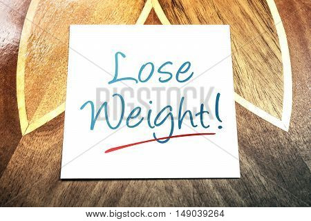 Lose Weight Reminder On Paper Lying On Wooden Table