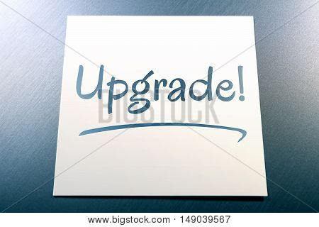 Upgrade Reminder On Paper For Today Lying On Aluminium