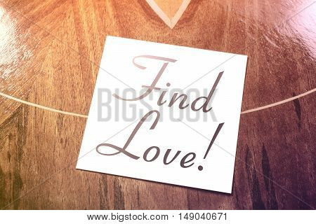 Find Love Reminder On Paper Lying On Wooden Table