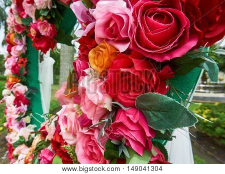 Close up picture of Colorful faked roses for decoration.