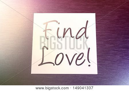 Find Love Reminder On Paper Lying On Brushed Aluminum