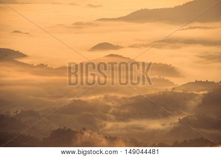 The fog cover the high mountains in northern Thailand when the sunrise.