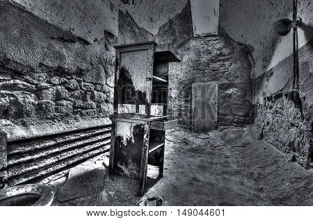 Abandoned prison cell inside Eastern State Penitentiary