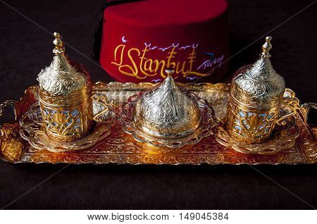 Turkish coffee set with Turkish line on the background