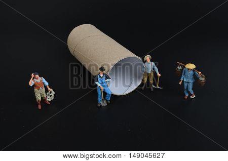 Group Of Tiny Miniature Artisans Working