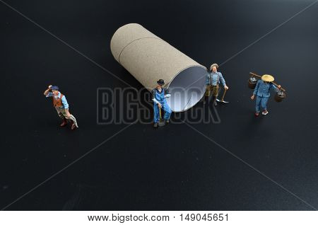 Group Of Tiny Miniature Artisans Working