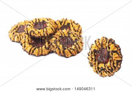 Single cookie next to Pile of round cookies with the pieces of chocolate isolated over the white background