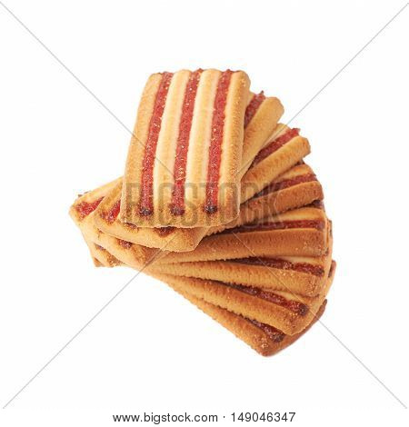 Twisted stacl of square cookies with jam stripes isolated over the white background