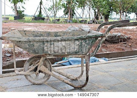 Dirty cart mortar for buildings construction, dirty cement cart, construction trolley, dirty cement wheelbarrow cart at construction