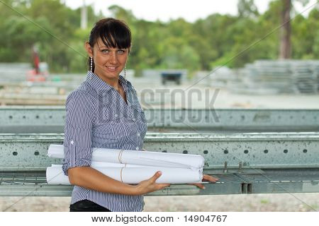 Young Engineer Woman In The Warehouse