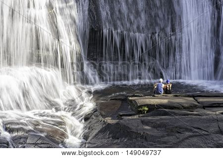 Young Couple Enjoying The View At High Falls In The DuPont State Forest In North Carolina