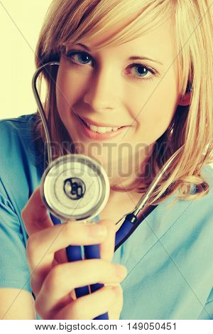Smiling pretty nurse holding stethoscope