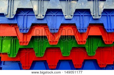 Plastic crates and boxes at transportation pallet