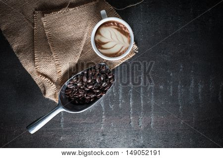 Coffee bean on black stone background. Top view