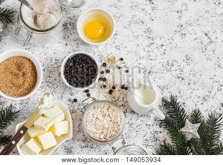 Christmas baking background. Flour sugar butter rolled oats eggs chocolate chips on a light background. Baking ingredients