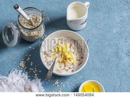 Porridge with fruit. Delicious healthy breakfast. On a blue background top view