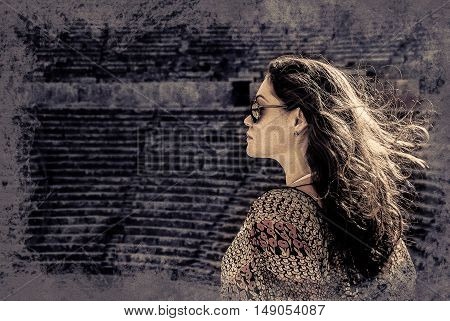 girl in sunglasses at sunset in Aspendos amphitheatre, Antalya, Turkey. Vintage painting, background illustration, beautiful picture, travel texture