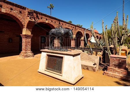 San Juan Capistrano, CA, USA --September 25, 2016: Empty Saddles horse statue at the Mission San Juan Capistrano in Southern California, United States. Editorial use only.