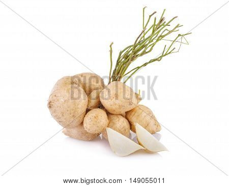 whole and cut yam bean or jicama with stem on white background