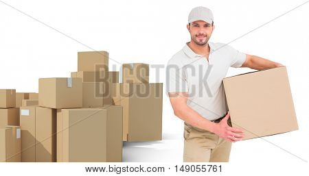 Delivery man with cardboard box against arrangements of cardboard boxes
