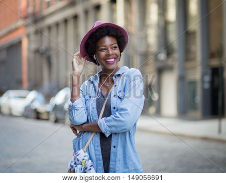 Portrait of young African American woman on city street. Photographed in Soho NYC.
