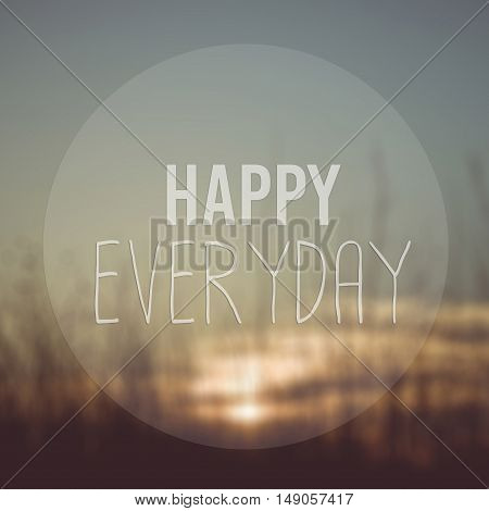 Happy Everyday word on blurred sunset with vintage filter background