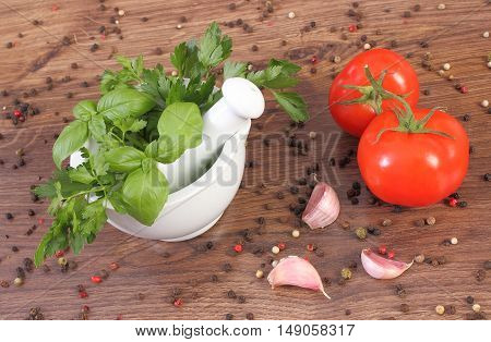 Parsley And Basil In Mortar, Spices With Vegetables On Rustic Boards