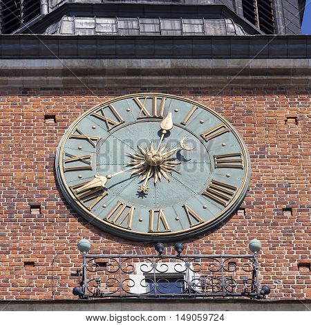 Clock on Hall Tower on Main Market Square Krakow Poland.