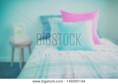 Blur Image Of Light Blue And Pink Pillow On Sweet Bedding And Picture Frame On Bedside Table