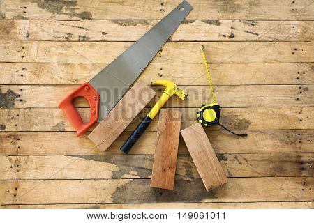 old vintage hand tools on wooden background