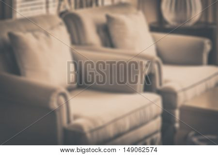 Blur Image Of Decorative Pillows On A Casual Sofa In Luxury Living Room With Vintage Style Effect