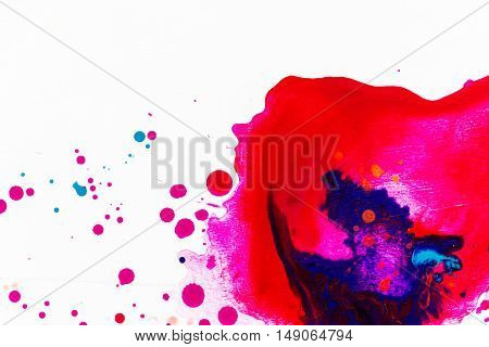 color splashes of water color paint on a white background