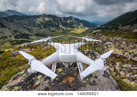 Quadracopter ready to fly high mountain background